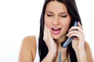 woman on phone dental emergency